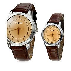 preiswerte Armbanduhren für Paare-Herrn / Damen / Paar Modeuhr / Armbanduhr Schlussverkauf Band Charme Schwarz / Braun